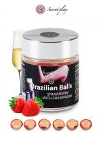 6 Brazillian balls - fraise & champagne : La chaleur du corps transforme la brazilian ball en liquide glissant au parfum fraise & champagne, votre imagination s'en trouve exacerbée.